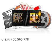 4K TV, popcorn and film strip on a white background. Стоковое фото, фотограф Zoonar.com/Roman Ivashchenko / easy Fotostock / Фотобанк Лори