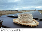 A hat in the car Rural landscape outside the window. Стоковое фото, фотограф Ирина Аринина / Фотобанк Лори