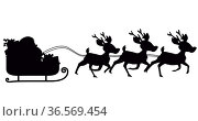 Image of black silhouette of santa claus in sleigh being pulled by reindeer on white background. Стоковое фото, агентство Wavebreak Media / Фотобанк Лори