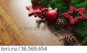 Video of christmas decorations with stars and copy space on wooden background. Стоковое видео, агентство Wavebreak Media / Фотобанк Лори