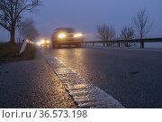 Lighted cars at dusk on main road. Стоковое фото, фотограф Richard Semik / easy Fotostock / Фотобанк Лори