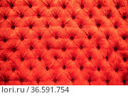 Close up background texture of scarlet red capitone genuine leather... Стоковое фото, фотограф Zoonar.com/Nadtochiy Vladimir / easy Fotostock / Фотобанк Лори