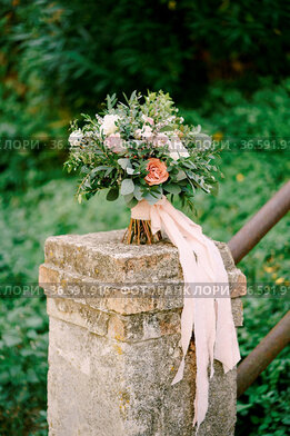 Bridal bouquet of white and pink roses, eustoma, branches of eucalypt...