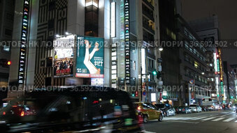 Video of night lights of Ginza. Logos, advertisement and banners entice to the shops and restaurants. Tokyo. Japan