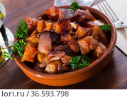 Spanish dish - roasted pig nose and cheeks. Стоковое фото, фотограф Яков Филимонов / Фотобанк Лори