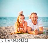 Laughing couple enjoying nature over sea background. Attractive man... Стоковое фото, фотограф Zoonar.com/Dasha Petrenko / easy Fotostock / Фотобанк Лори