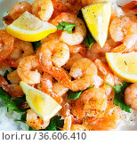 Fried shrimps with rice and lemons. Стоковое фото, фотограф Zoonar.com/Ruslan Nassyrov / easy Fotostock / Фотобанк Лори
