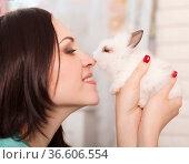 Woman holding little cute white rabbit, close up. Стоковое фото, фотограф Zoonar.com/Dasha Petrenko / easy Fotostock / Фотобанк Лори