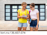 Girls talking about homework outdoors. Стоковое фото, фотограф Яков Филимонов / Фотобанк Лори