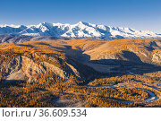 Top view of the Kurai Steppe, the Chuya River Valley and the snow-covered North Chuya Ridge in autumn at sunset. Altai Republic, Russia. Стоковое фото, фотограф Наталья Волкова / Фотобанк Лори