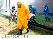 Man in chemical protection suit, carrying out the decontamination area. Стоковое фото, фотограф Zoonar.com/Volodymyr Khodariev / easy Fotostock / Фотобанк Лори