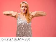 Upset disappointed fooled blond elegant girlfriend in silver dress... Стоковое фото, фотограф Zoonar.com/Seva Levytskyi / easy Fotostock / Фотобанк Лори