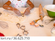 Hands of african american messy girl baking in kitchen. Стоковое фото, агентство Wavebreak Media / Фотобанк Лори
