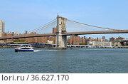 Famous Brooklyn Bridge (1883), hybrid cable-stayed, suspension bridge in New York City. United States. Редакционное фото, фотограф Валерия Попова / Фотобанк Лори
