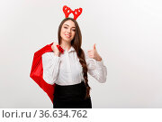 Christmas Concept - Young beautiful business woman in christmas theme... Стоковое фото, фотограф Zoonar.com/Phongthorn Hiranlikhit / easy Fotostock / Фотобанк Лори