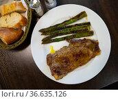 Steak entrecote of beef with baked asparagus at plate. Стоковое фото, фотограф Яков Филимонов / Фотобанк Лори