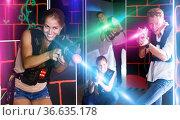 Young team playing laser tag game. Стоковое фото, фотограф Яков Филимонов / Фотобанк Лори