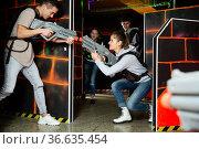 Young people having fun on lasertag arena. Стоковое фото, фотограф Яков Филимонов / Фотобанк Лори