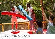 Men on inflatable gladiator fight arena. Стоковое фото, фотограф Яков Филимонов / Фотобанк Лори