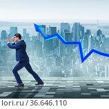 Businessman supporting increase in economy. Стоковое фото, фотограф Elnur / Фотобанк Лори