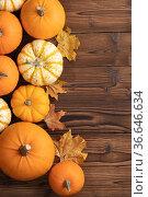 Pumpkins with fall leaves. Стоковое фото, фотограф Иван Михайлов / Фотобанк Лори