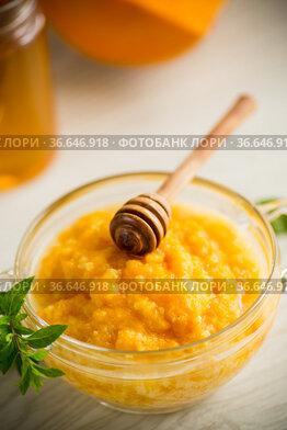 sweet boiled pumpkin porridge in a bowl with honey