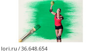 Caucasian female handball player against green paint stain and paint brush on white background. Стоковое фото, агентство Wavebreak Media / Фотобанк Лори