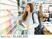 Woman consumer choosing tiles color samples in hardware store. Стоковое фото, фотограф Яков Филимонов / Фотобанк Лори