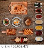 Top view of Turkish breakfast isolated on rustic wooden table. Стоковое фото, фотограф Zoonar.com/Piotr Stryjewski / easy Fotostock / Фотобанк Лори