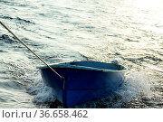 Boat is tethered behind fishing schooner, on trailers, under tow. Стоковое фото, фотограф Zoonar.com/Maximilian Buzun / easy Fotostock / Фотобанк Лори