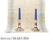 Kerzenständer auf Leinentuch - Candleholder on linen. Стоковое фото, фотограф Zoonar.com/lantapix / easy Fotostock / Фотобанк Лори