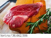 Raw beef fillet with rosemary. Стоковое фото, фотограф Яков Филимонов / Фотобанк Лори