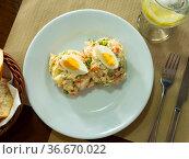 Russian salad of diced boiled vegetables garnished with eggs quarters. Стоковое фото, фотограф Яков Филимонов / Фотобанк Лори