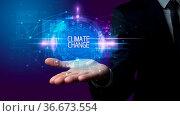 Man hand holding CLIMATE CHANGE inscription, technology concept. Стоковое фото, фотограф Zoonar.com/rancz / easy Fotostock / Фотобанк Лори