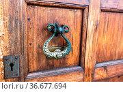 Antique cathedral Wooden door with doorknob made of bronze. Door with... Стоковое фото, фотограф Zoonar.com/Alexander Blinov / easy Fotostock / Фотобанк Лори