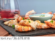 A closeup photo of plate of cooked shrimps with a sauce and a glass... Стоковое фото, фотограф Zoonar.com/Katerina Solovyeva / easy Fotostock / Фотобанк Лори