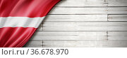 Latvia flag on old white wall. Horizontal panoramic banner. Стоковое фото, фотограф Zoonar.com/Laurent Davoust / easy Fotostock / Фотобанк Лори