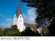 Old church of Nebel against blue sky, Amrum, Germany. Стоковое фото, фотограф Zoonar.com/Alexander Ludwig / easy Fotostock / Фотобанк Лори