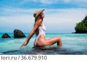 Side view of prettty brunette woman in sexy white swimsuit, sunglasses... Стоковое фото, фотограф Zoonar.com/Piotr Stryjewski / easy Fotostock / Фотобанк Лори