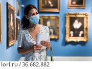 Woman standing in picture gallery. Стоковое фото, фотограф Яков Филимонов / Фотобанк Лори