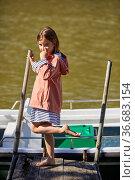 Girl 5-10 years on the jetty, Zumaia, Gipuzkoa, Basque Country, Spain. Стоковое фото, фотограф Javier Larrea / age Fotostock / Фотобанк Лори