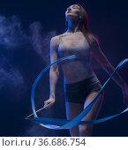 Woman exercising with ribbon in dust cloud view. Стоковое фото, фотограф Гурьянов Андрей / Фотобанк Лори