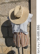 Bol, Croatia, A mannequin outside a clothing store with shorts and... Стоковое фото, фотограф A. Farnsworth / age Fotostock / Фотобанк Лори