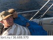 Hvar, Croatia A couple on a speed boat in the Adriatic. Стоковое фото, фотограф A. Farnsworth / age Fotostock / Фотобанк Лори