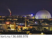 Stockholm, Sweden The Ericsson Globe Arena and cityscape at night. Стоковое фото, фотограф A. Farnsworth / age Fotostock / Фотобанк Лори