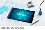 Tablet pc and doctor tools with EBOLA inscription, coronavirus concept. Стоковое фото, фотограф Zoonar.com/rancz / easy Fotostock / Фотобанк Лори