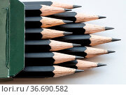 Sharp tips of set of black graphite pencils close up in green cartboard... Стоковое фото, фотограф Zoonar.com/Valery Voennyy / easy Fotostock / Фотобанк Лори