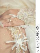 Wedding heart shape white garter close up traditional bride clothes. Стоковое фото, фотограф Zoonar.com/Olga Sapegina / easy Fotostock / Фотобанк Лори