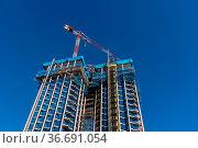 Madrid, Spain - February 14, 2021: Low angle view of Colon Towers... Стоковое фото, фотограф Zoonar.com/@jjfarquitectos / easy Fotostock / Фотобанк Лори