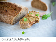 homemade liver pate with bread on a wooden table. Стоковое фото, фотограф Peredniankina / Фотобанк Лори